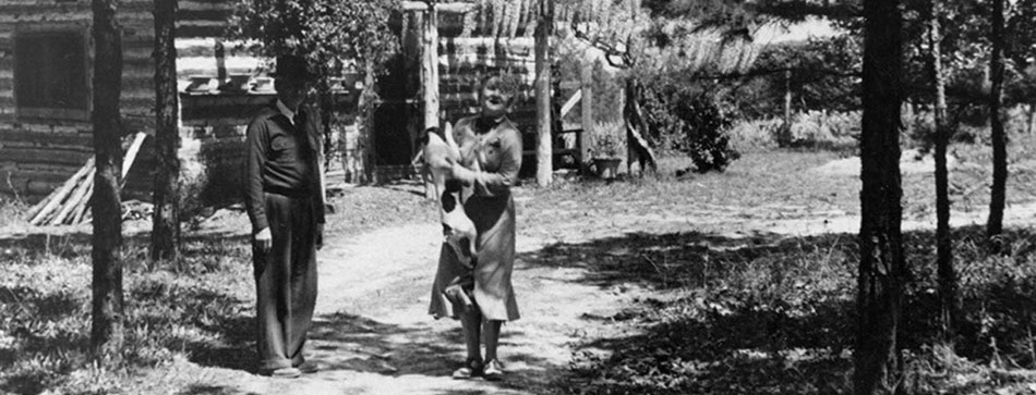 Jacques and Juliana in front of sales cabin, ca. 1938